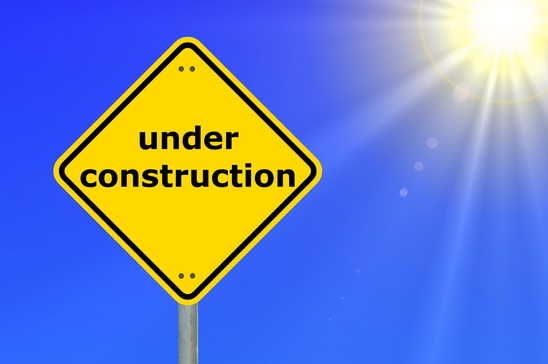 this website is under construction shown by yellow road sign