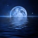 blue moon set on water
