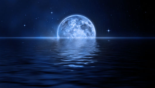 blue moon set on water